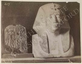 [Left] Small round-topped stela (plaque) showing the god Shed on its recto holding a lion and a g...