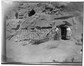 "[6.B] Annie A. Pirie (later Quibell) and Kate Quibell outside the dig ""house"" (rock-tomb)"