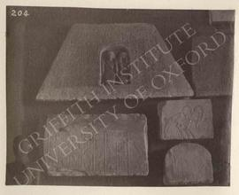 [Upper left] Pyramidion of Ptah...set with the deceased kneeling in a niche, Dyn. XVIII, provenan...