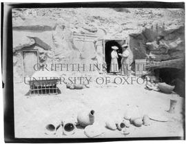 "[3.B] Annie A. Pirie (later Quibell) and Kate Quibell outside the dig ""house"" (rock-tomb)"