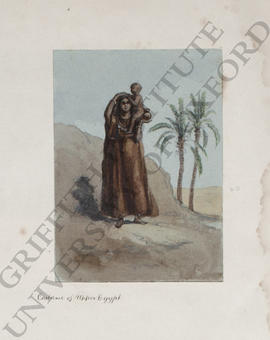 Upper Egypt, a portrait of a woman carrying a young child on her shoulder