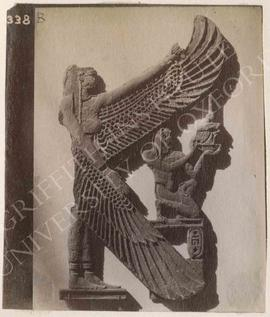 Part of a wooden naos showing Pedubastis III kneeling, protected by Isis, Dyn. XXII, provenance n...