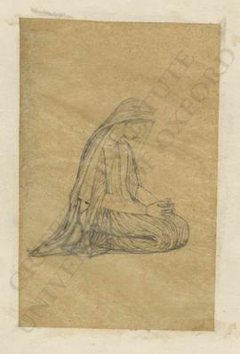 Woman kneeling with hands clasped in prayer