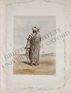 Egypt, portrait of a Bedouin sheikh with a gun and a sword, back view