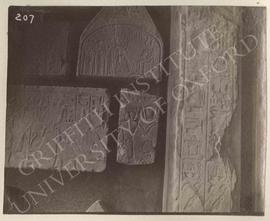 [Left upper left] Lower part of stela of Ptah-Kha with his wife and family before Anubis, Dyn. XI...