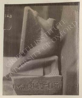 Headless statue of Neferhabef holding a stela dedicated to the ram of Amun-Re, red granite, New K...