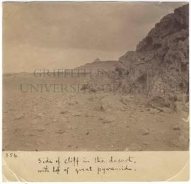[354] Side of cliff in the desert, with top of great pyramid.