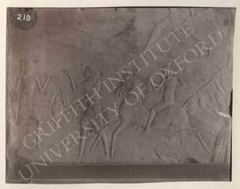 Block showing a military camp with chariots, horsemen, men carrying log, etc., from Saqqara, Tomb...