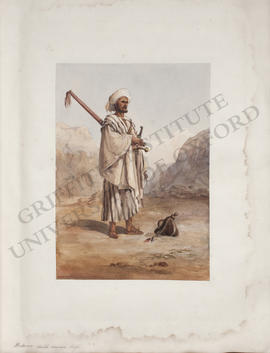 Egypt, portrait of a Bedouin sheikh with a gun and a sword