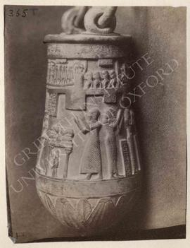Situla with the deceased and his wife (no names) before divinities, etc., bronze, Ptolemaic Perio...