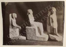[Left] Seated statue of Amenmosi, Dyn. XIX-XX, provenance not known, now in Turin, Museo Egizio, ...
