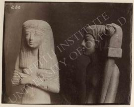 [Left] Statue of woman, wood, not identified, now in Turin, Museo Egizio; [right] statue of a man...
